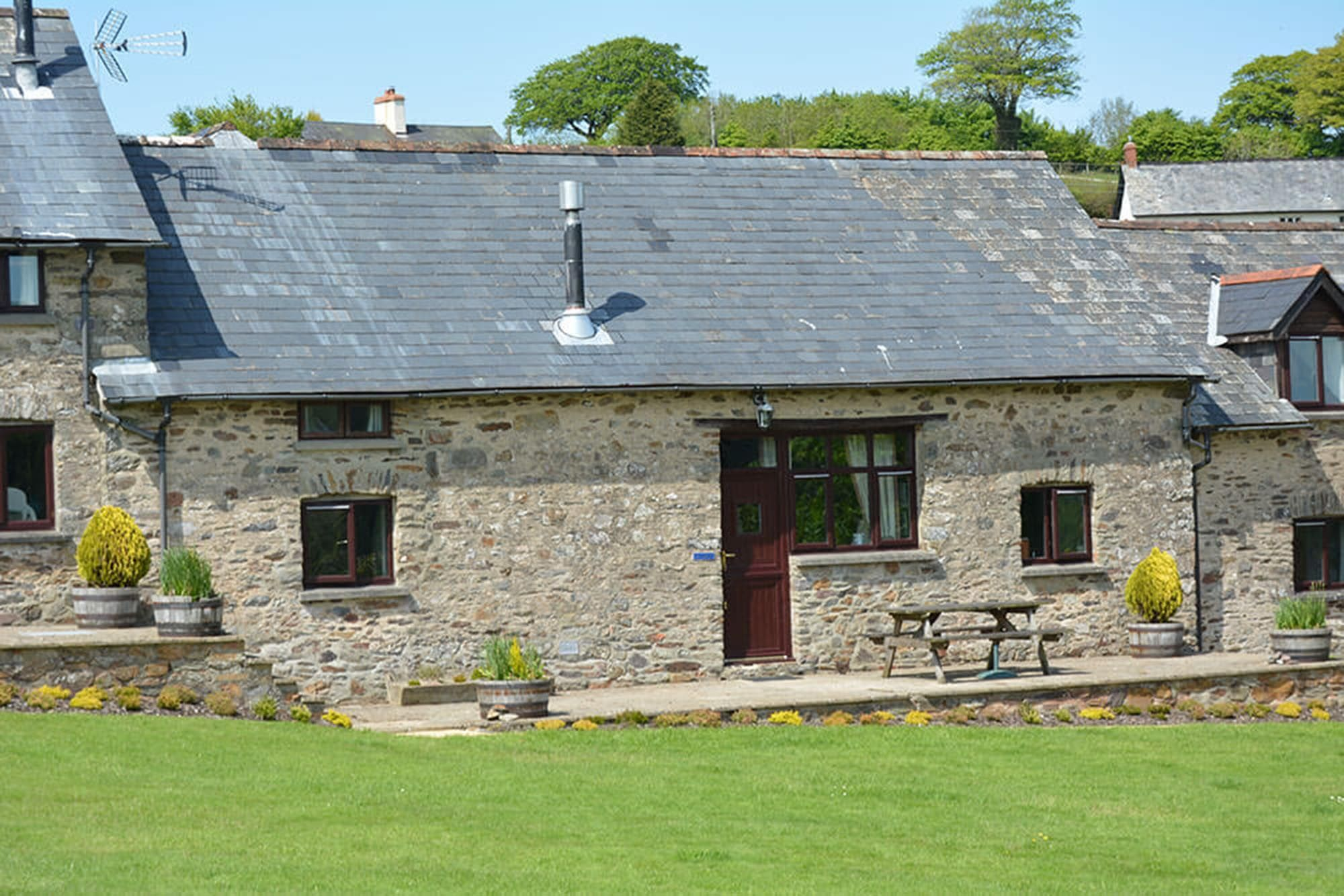 Kiri Cottage, sleeping 6, is a traditional stone barn conversion with a private patio area and garden furniture