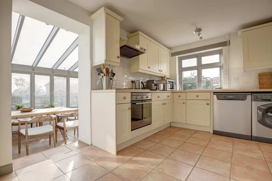 Egmere End Cottage | Kitchen through to conservatory