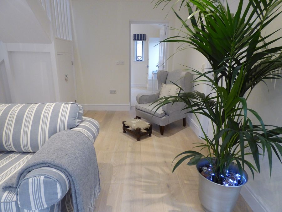 Spring Cottage | Sitting room through to bed 2