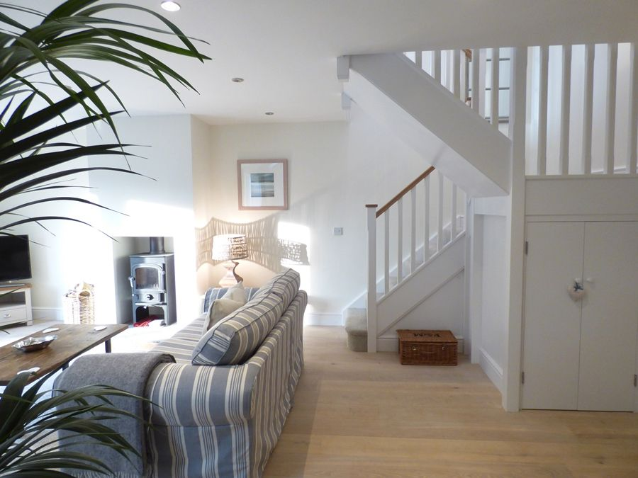Spring Cottage | Sitting room and staircase
