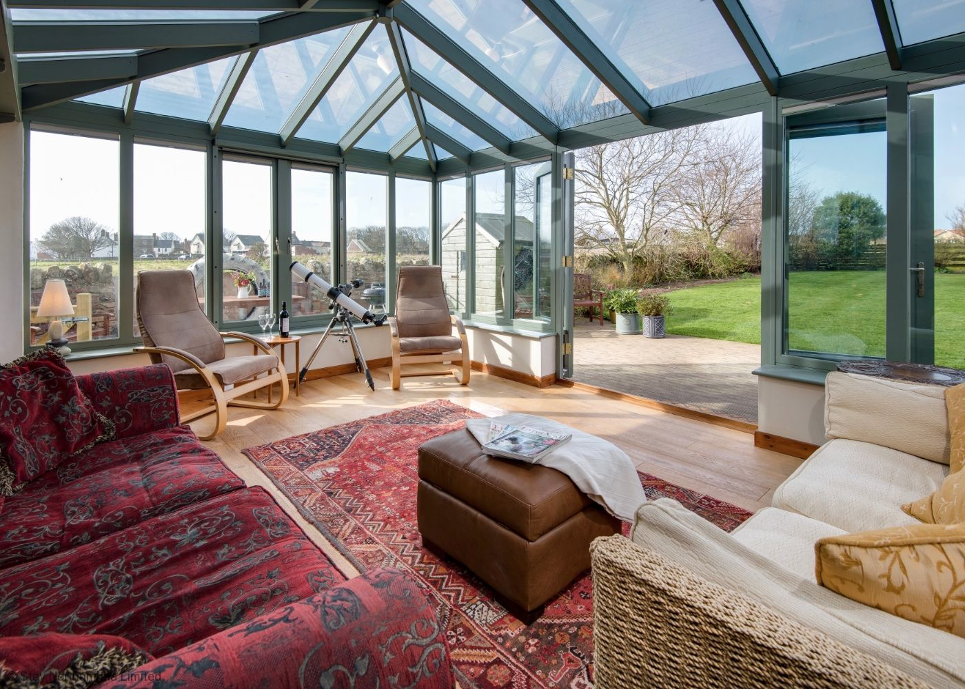 Bright & Airy Conservatory leading out to enclosed garden