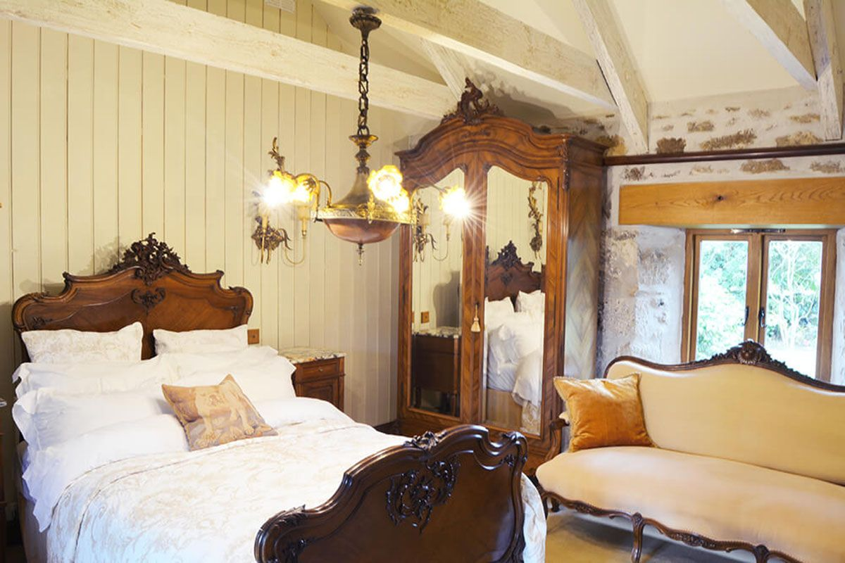 Ground floor: Master bedroom with double bed, roll top bath, exposed stone walls & rafters. En suite wc