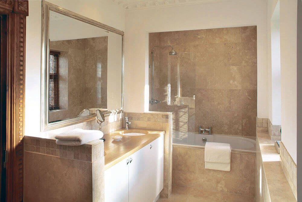 Lower ground floor: En suite bathroom with shower over bath