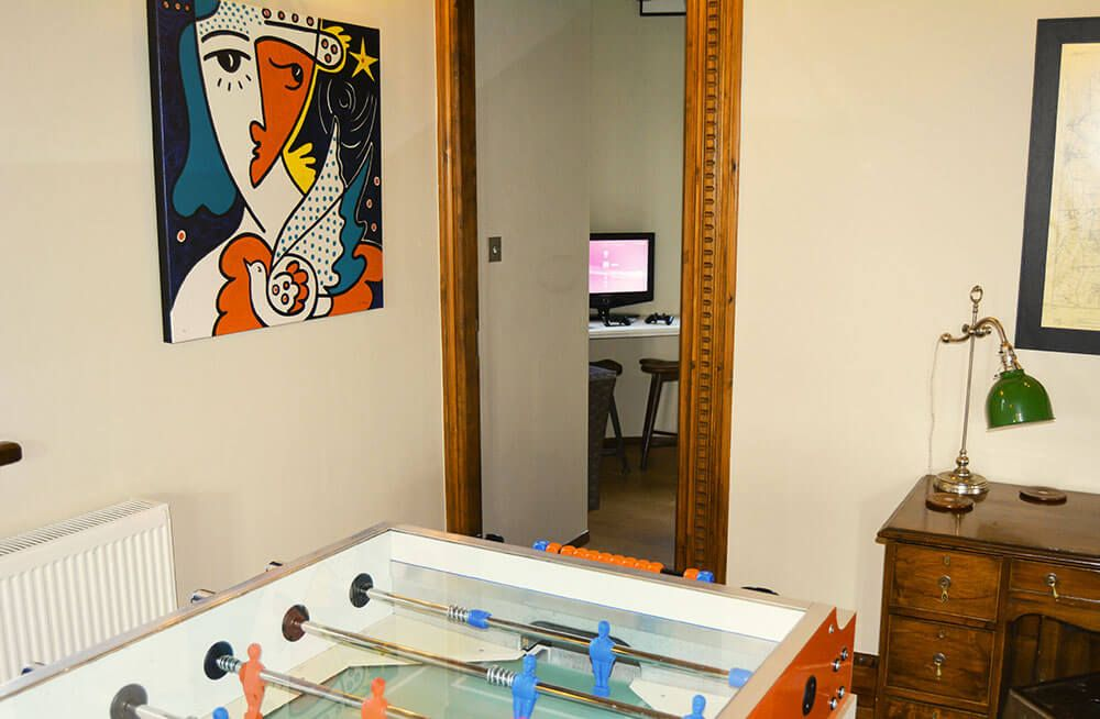 Ground floor: Fire up the table football in the reception room or play on the PS3 in the study
