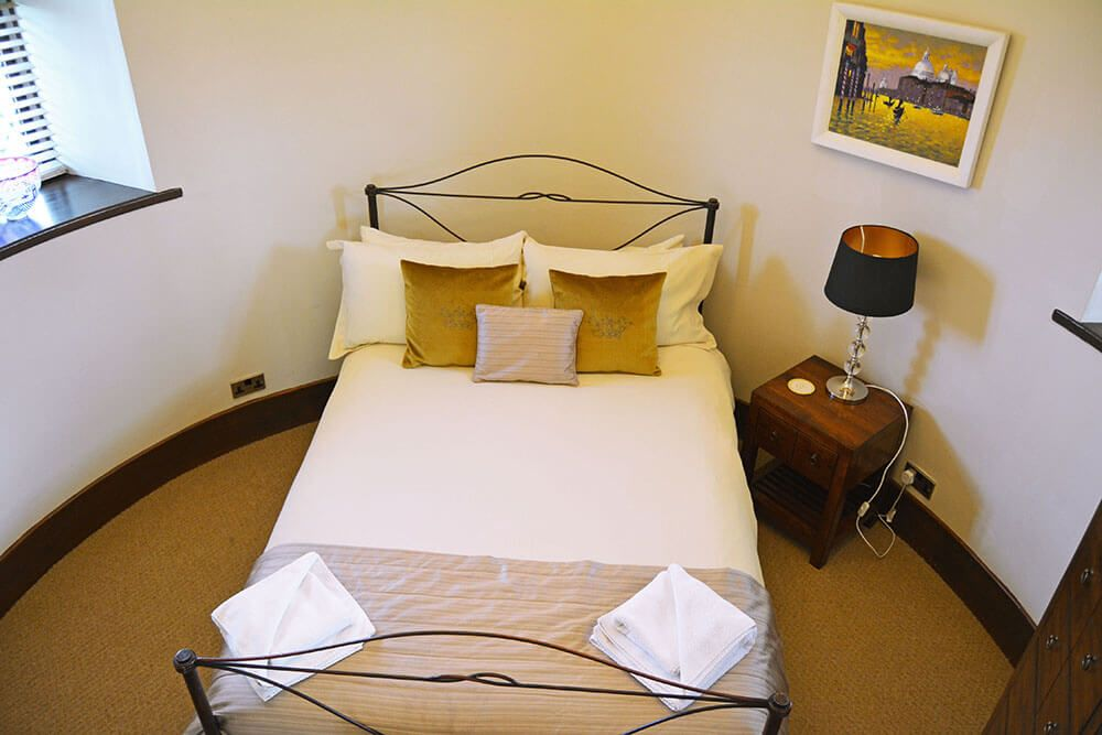 """Tower first floor: Circular double bedroom with 4'6"""" bed and access to the roof terrace"""