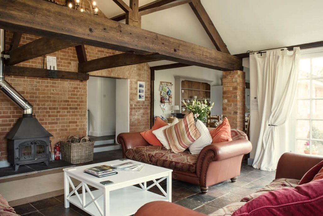Elliotts House ground floor: Large family room with a vaulted ceiling, beams and wood burner