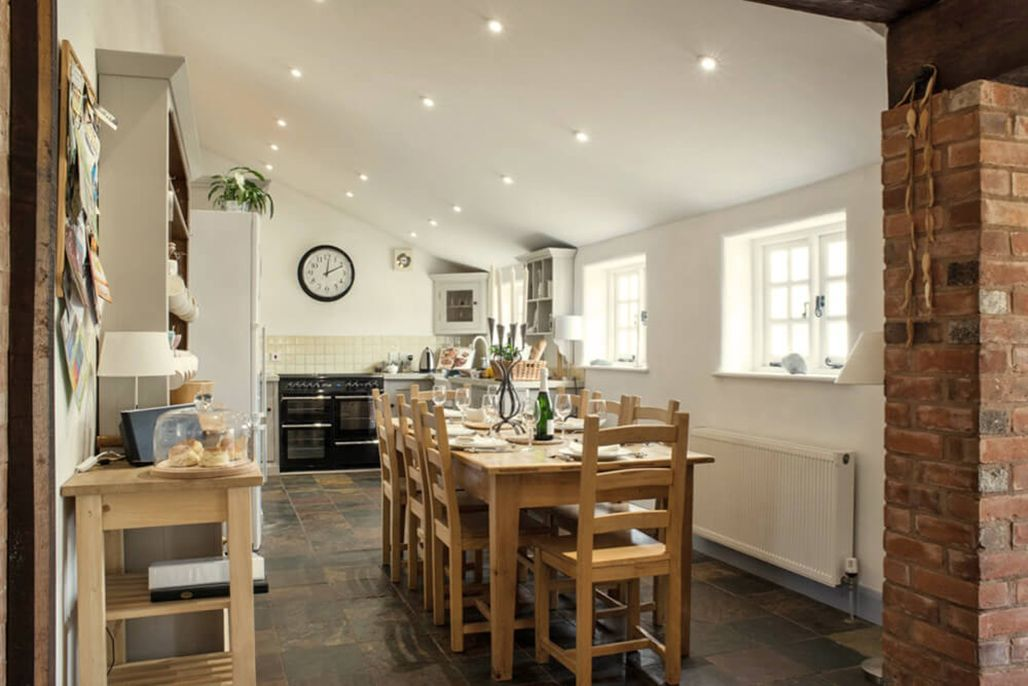 Elliotts House ground floor: Well equipped open plan kitchen with dining area, seating all 14 guests