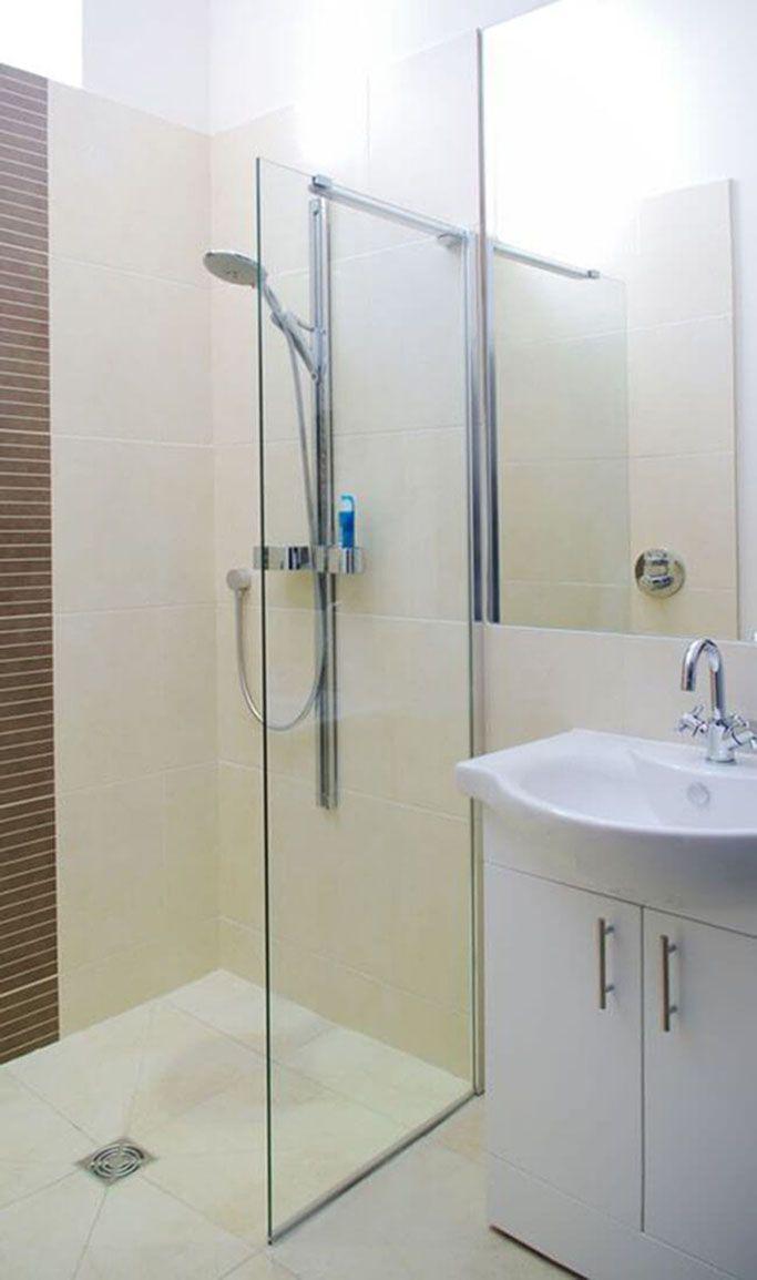 Second floor: En suite walk-in shower room to twin/double bedroom