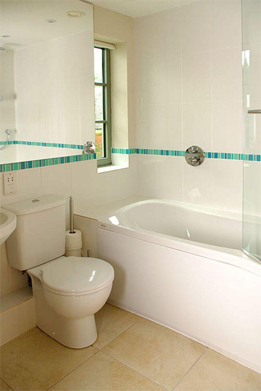 First floor: Bathroom with a shower over the bath.