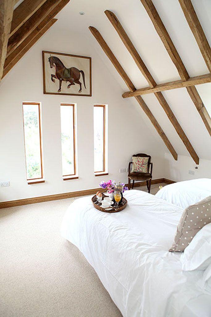 Second floor: Twin room with oak beams and en suite walk-in shower