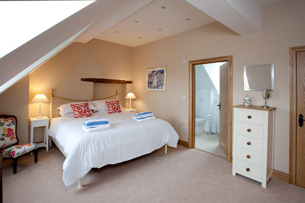 First floor: Master bedroom with a super-king brass bed and en suite bathroom