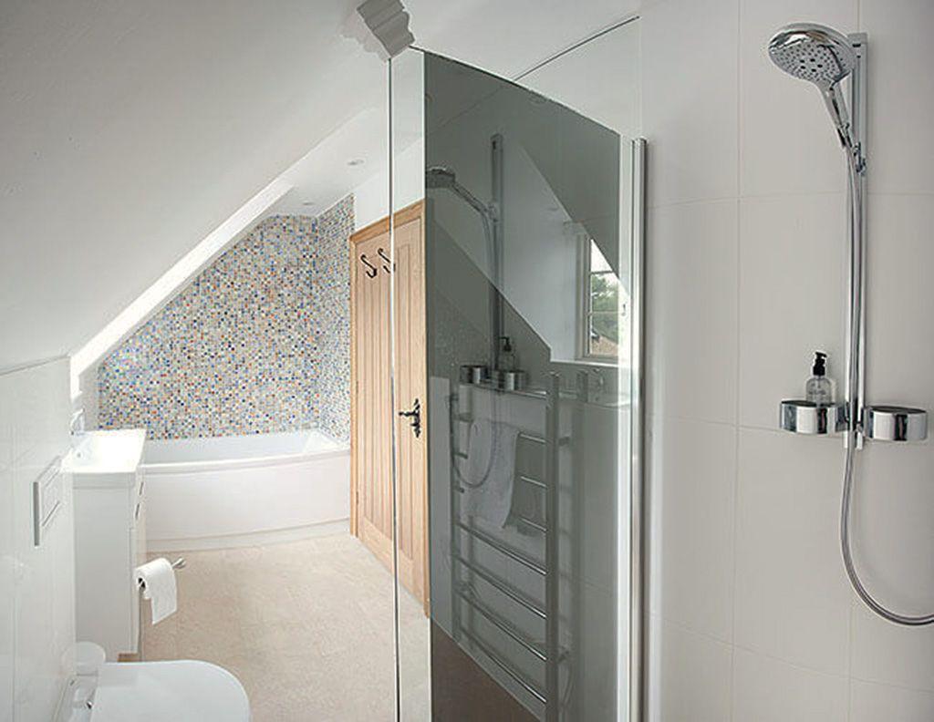 First floor: En suite bathroom to master bedroom with bath and walk-in shower