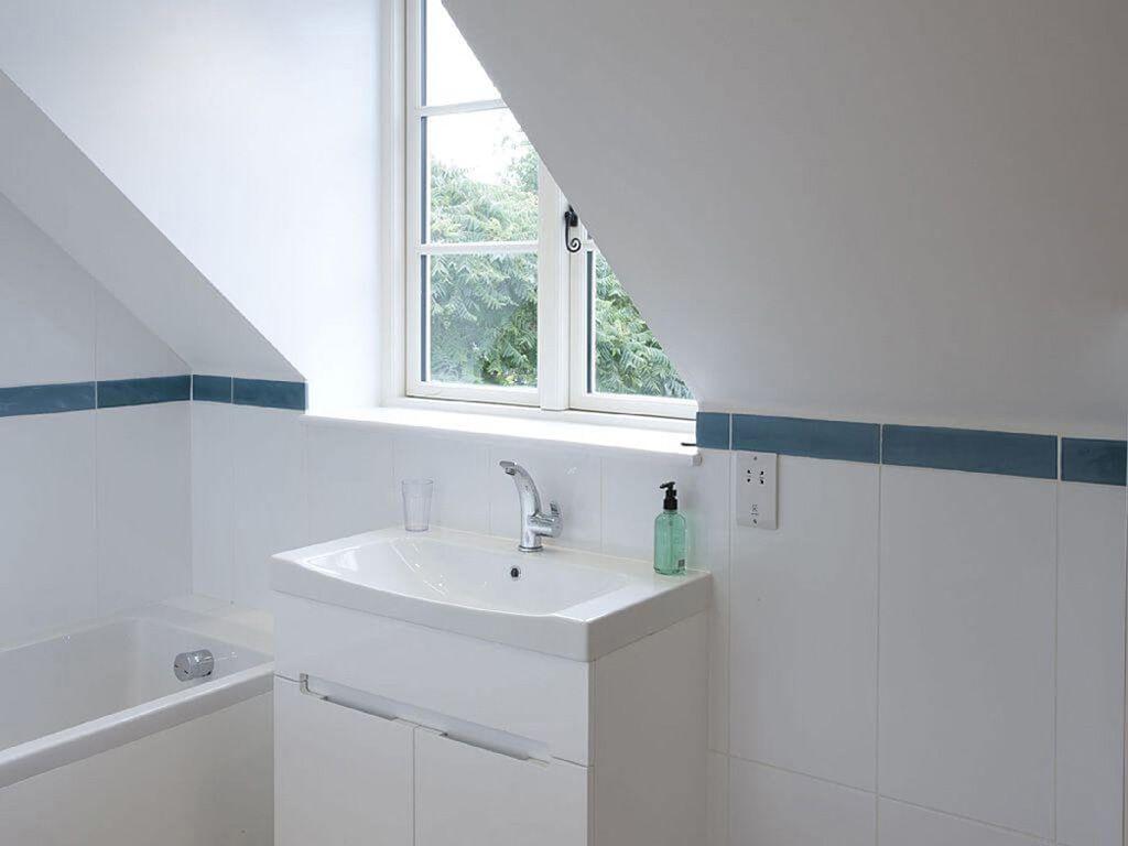 First floor: En suite bathroom to twin room with bath and walk-in shower