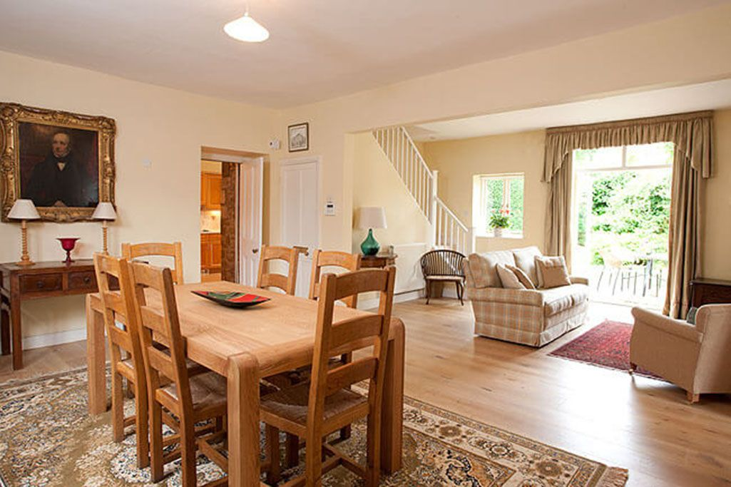 Ground floor: Dining and sitting areas with open fire and French doors to the garden