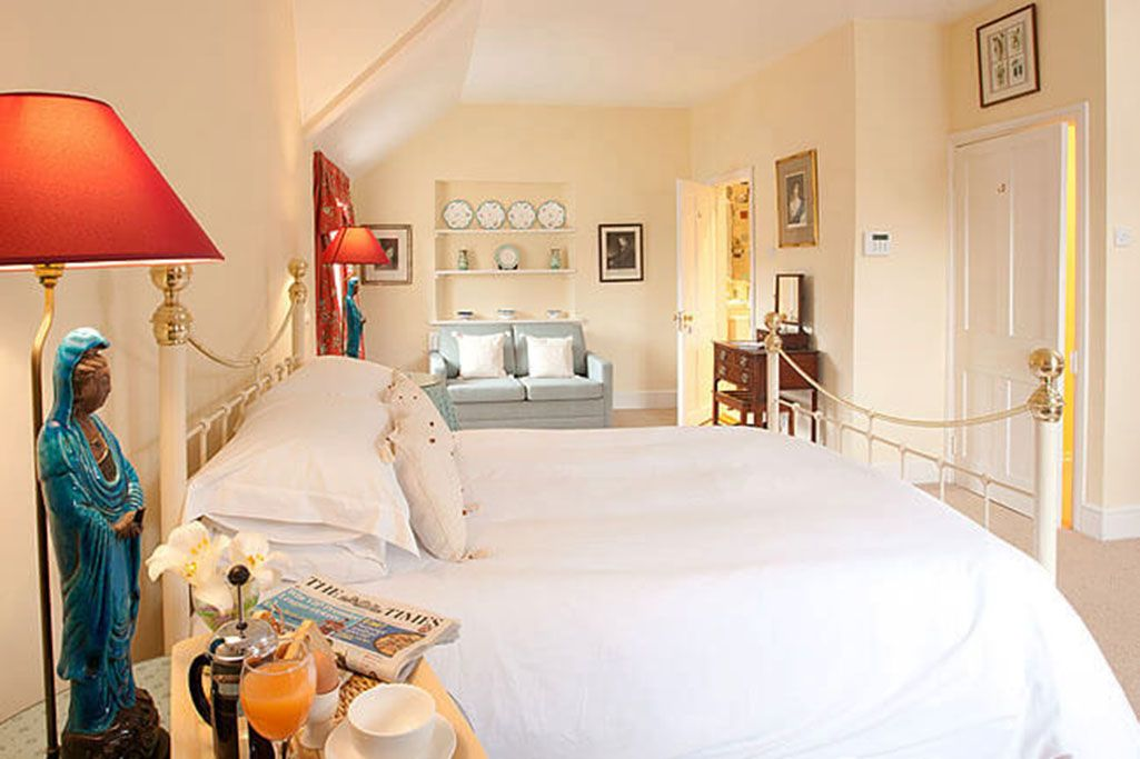 First floor: Double aspect master bedroom suite with a super-king bed and en suite shower room