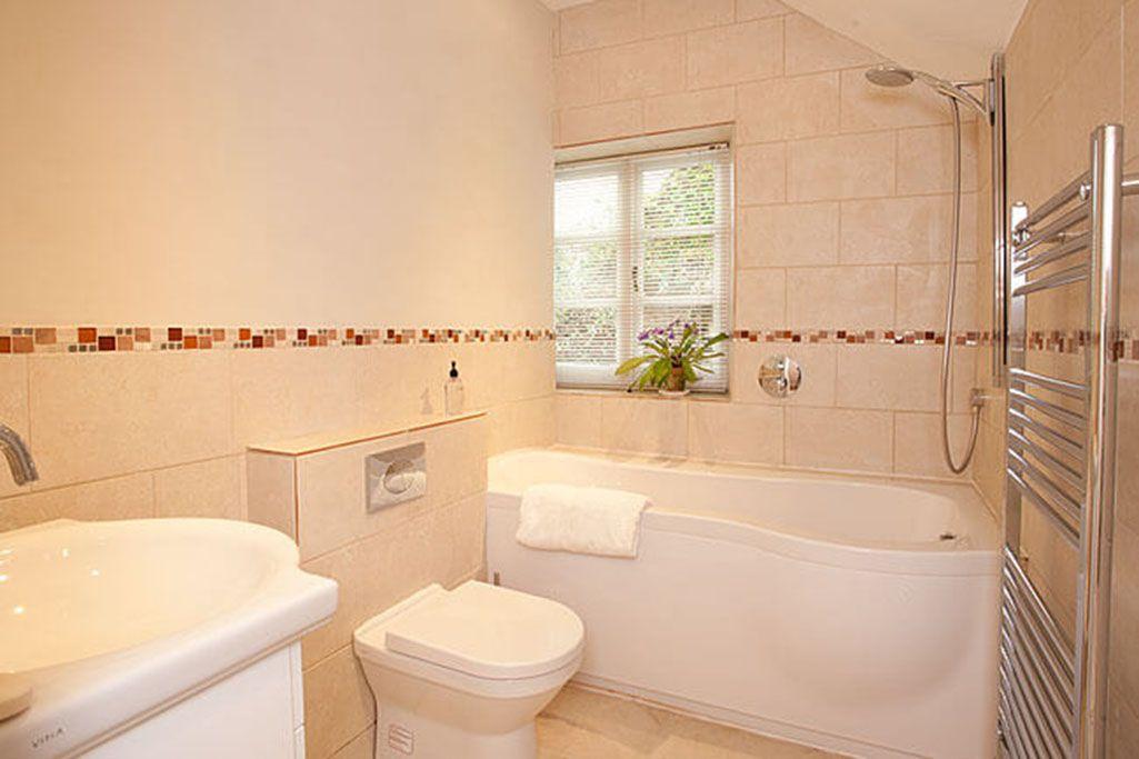 First floor: Family bathroom with shower over the bath