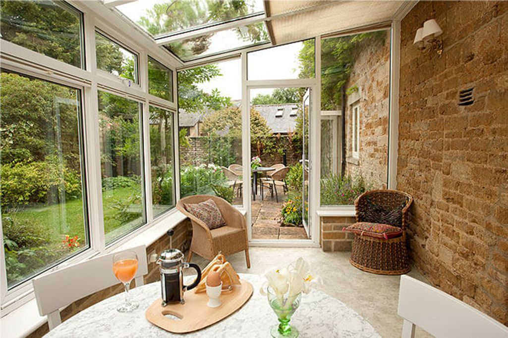 Ground floor: South facing conservatory with breakfasting table and chairs, overlooking the garden