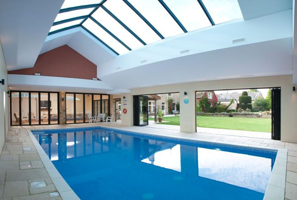 Take a dip in the glorious shared indoor pool overlooking the gorgeous gardens