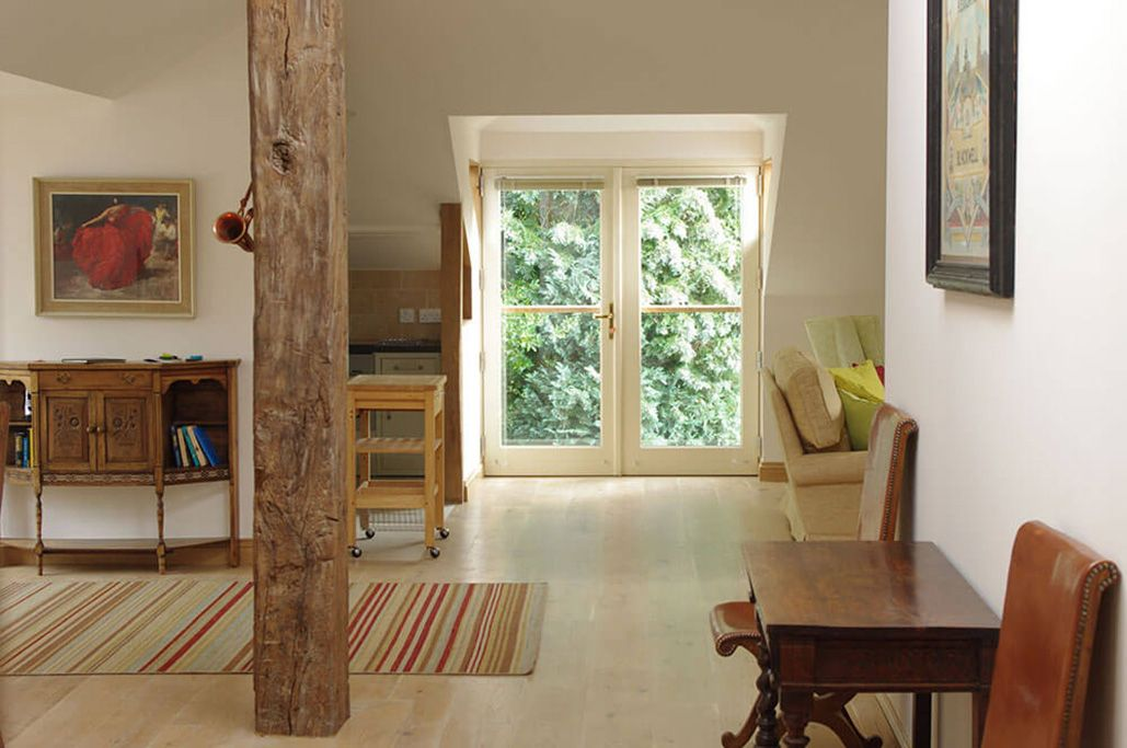 Wonderfully light open plan living space with limed oak flooring and beams