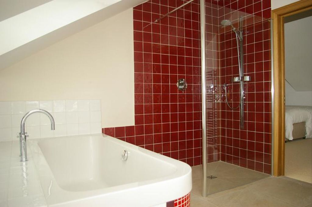 Family bathroom with double ended bath with shower over, and separate large walk-in shower