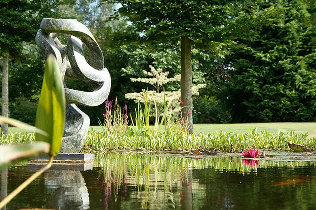 Explore five acres of beautiful shared landscaped gardens with two ponds, topiary and sculptures