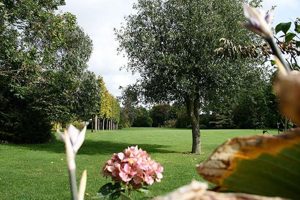 Shared five acres of beautifully landscaped grounds