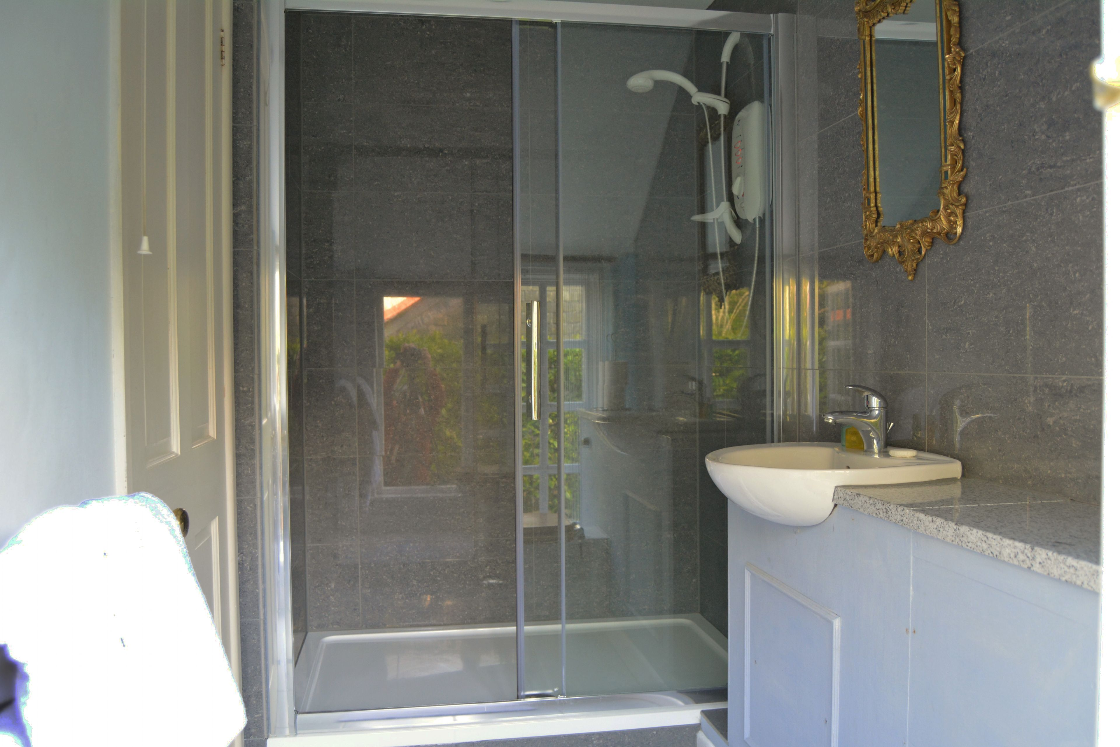 A separate shower room adjoins the bedroom