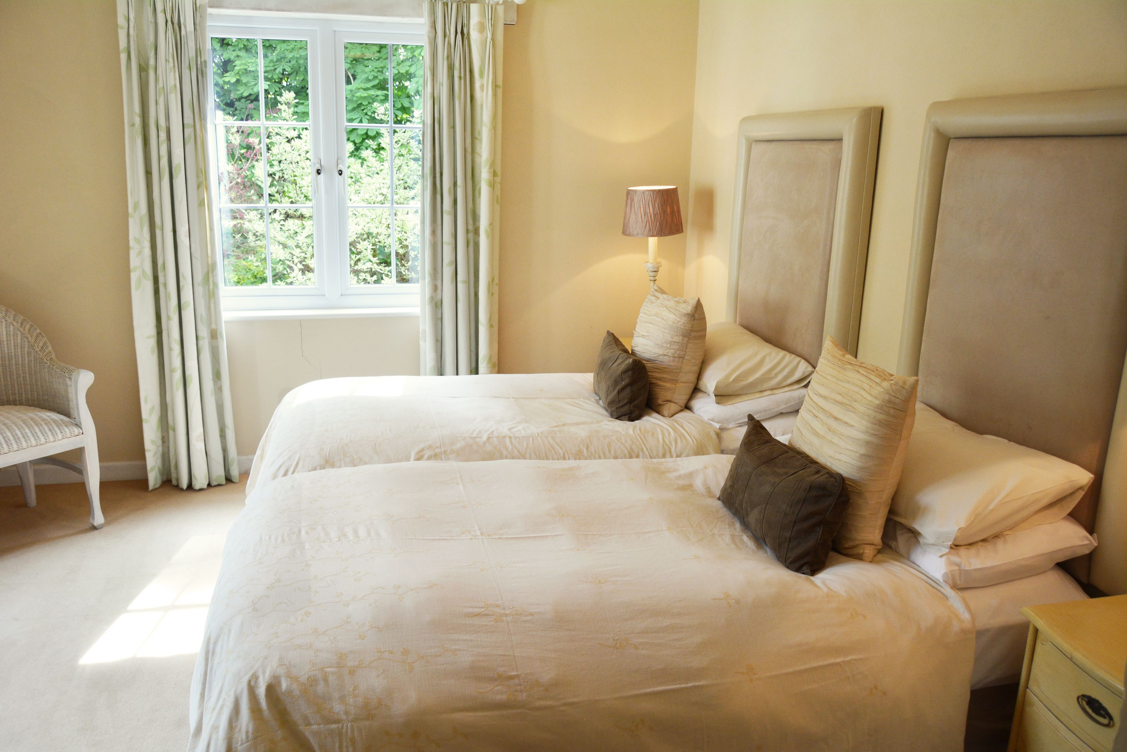Large twin bedroom with a spacious separate dressing area and en suite shower room