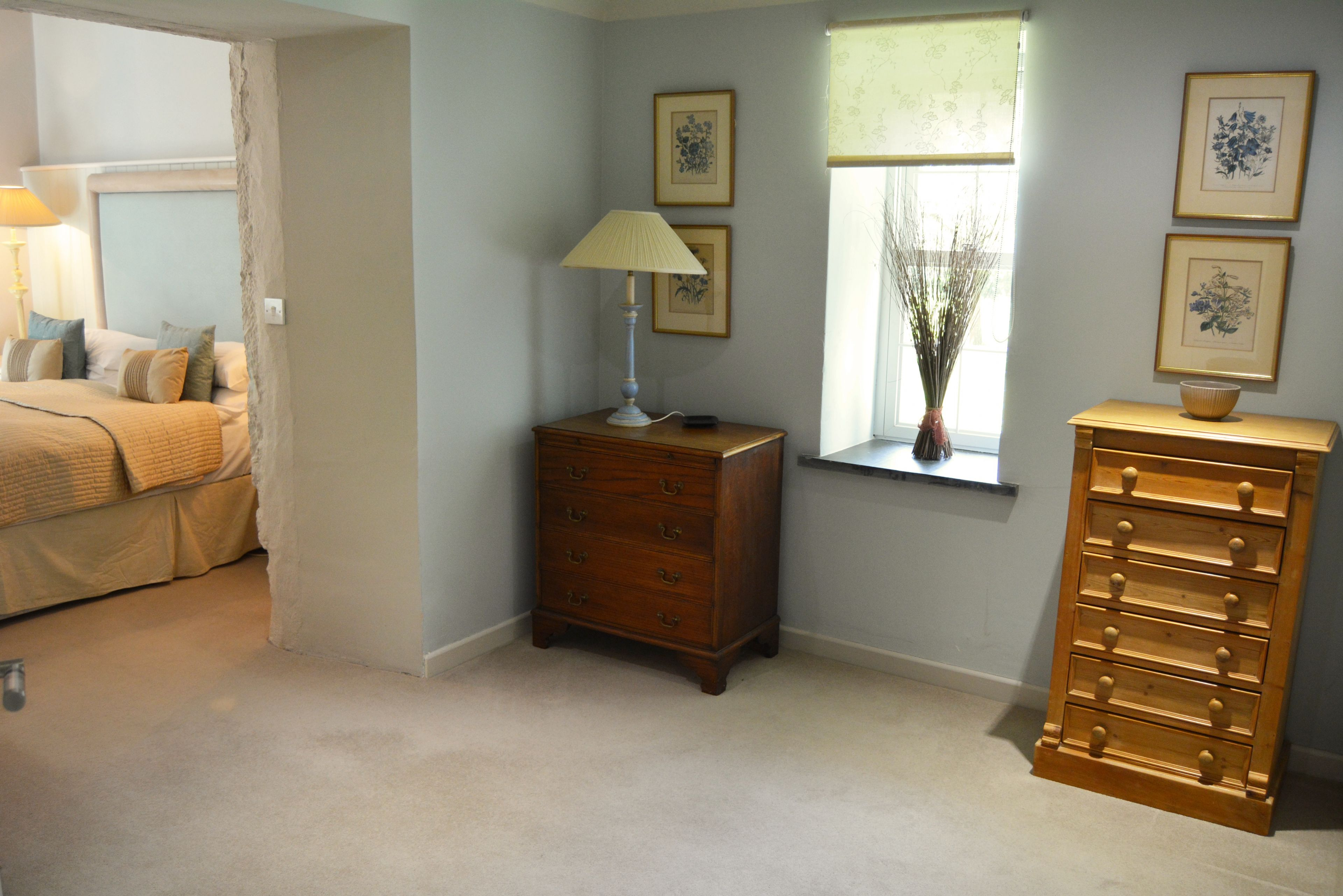 Spacious separate dressing area to bedroom with super king size bed