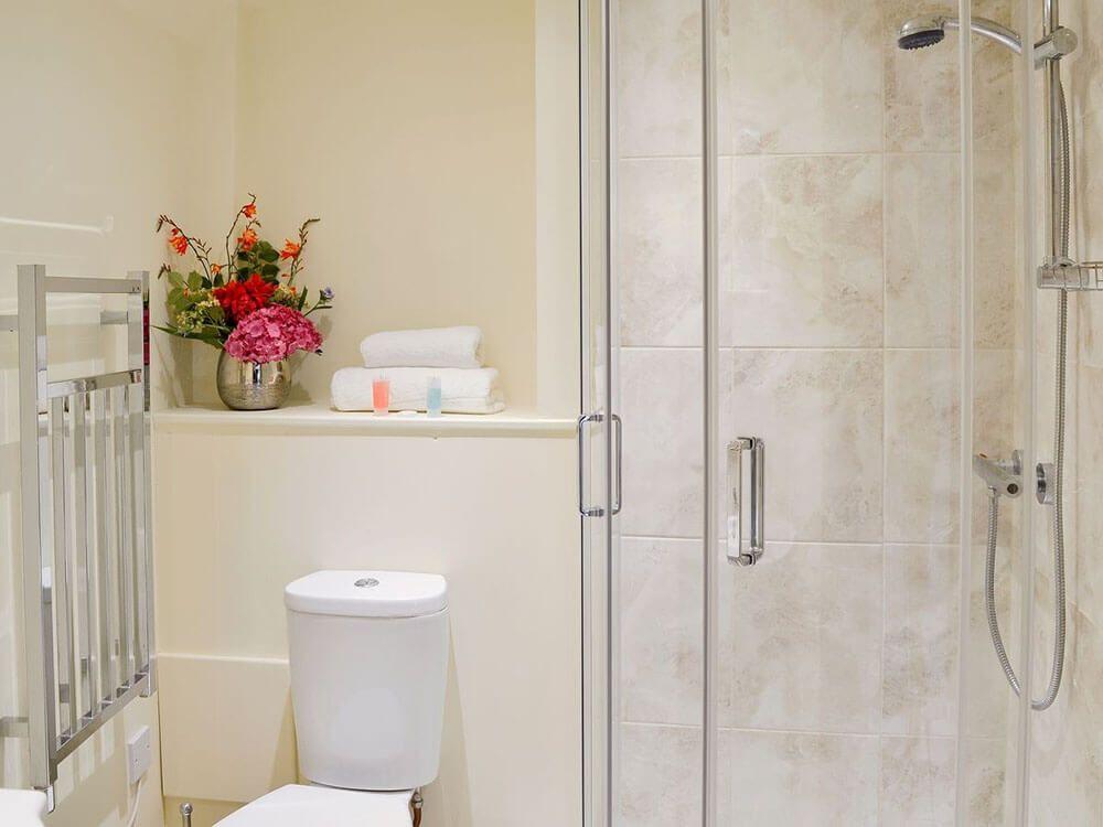 En suite shower room to double/twin bedroom