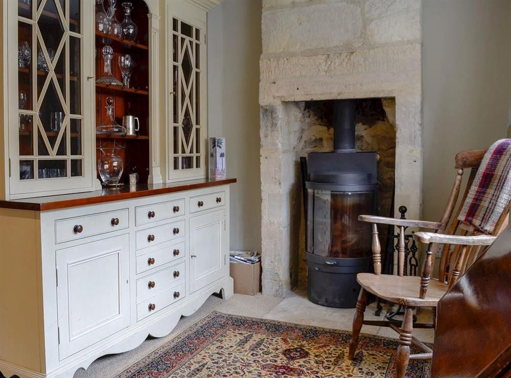 snug area with wood burning stove logs and kindling included