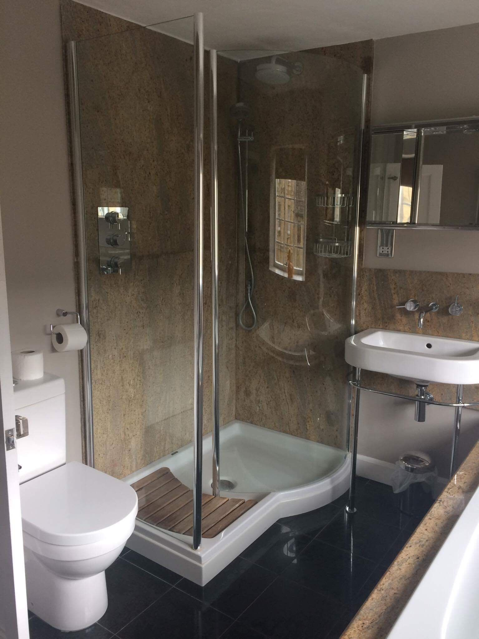 Walk in shower twin basins with vanity cupboard and WC ensuite
