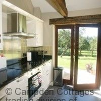 Modern fully equip kitchen with patio doors leading to enclosed garden