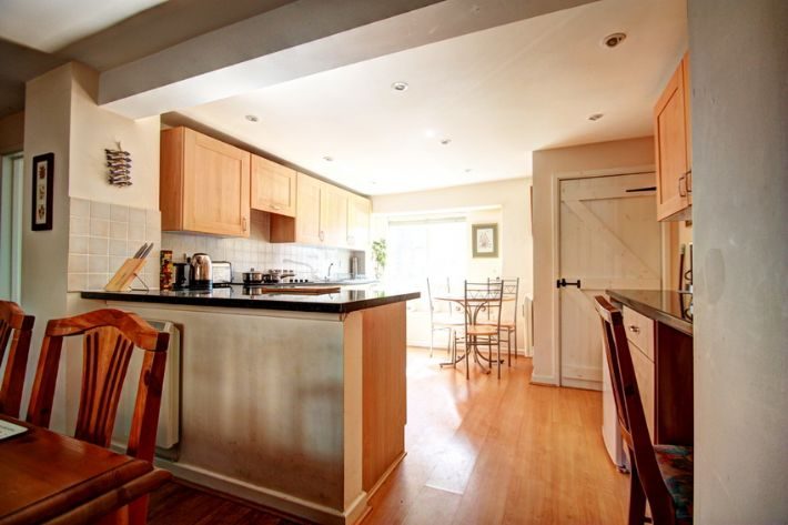 Spacious kitchen with 2 separate seating areas