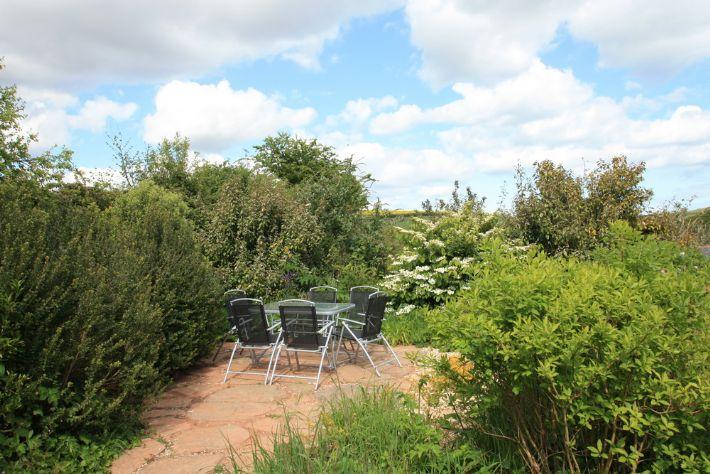 Sunny terraced garden overlooking Frogmore Creek