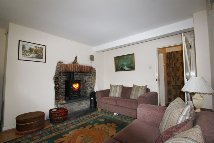 Cozy sitting room with woodburner