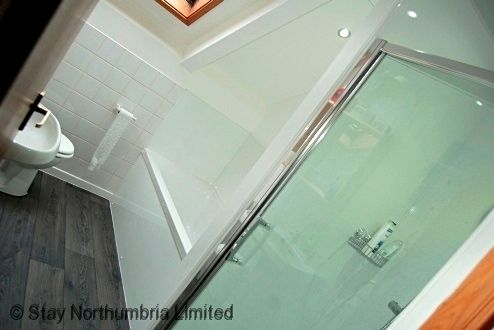 Upstairs bathroom with separate shower enclosure