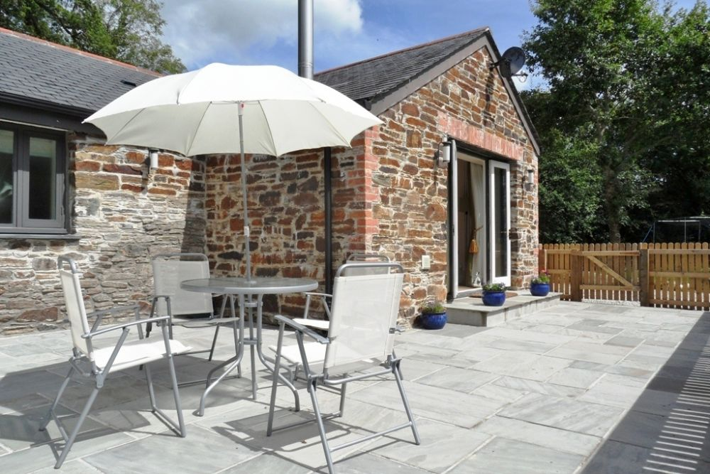 Large sunny patio with views across the fields