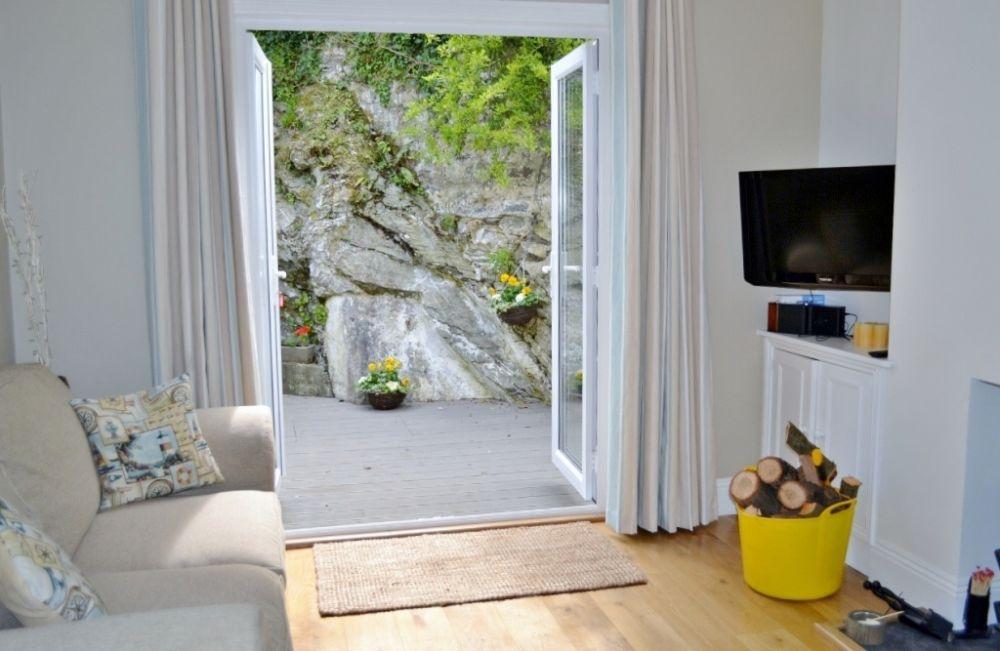 Sitting room with doors to patio & garden