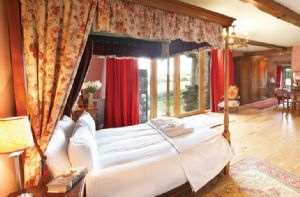 First floor: Cromwell's Folly occupies the first floor of the South Tower and has its own bathroom with a cast iron roll top bath and separate shower. It also benefits from a private juliette balcony overlooking the fells