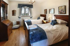 First floor: The Greystoke Room: Twin bedroom with 3' single beds with private en suite includes a shower bath room