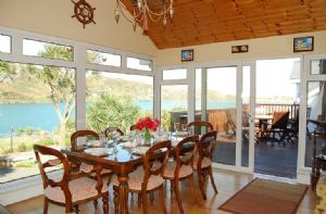 Dining area leading to decked patio with wonderful views