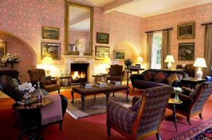 Hamilton Wing Ground floor: Drawing room with open fireplace and piano.