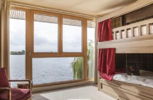 Bedroom with cabin beds and views over Bowmoor lake