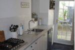 Harbour Heights - Kitchen showing hob, dishwasher & yard door
