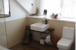 Harbour Heights main bathroom with bath and shower over head