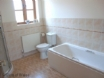 Ground floor bathroom is fitted with a bath & separate walk in shower