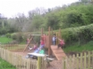 Full sized enclosed play area with swings, slide, trampoline etc