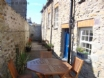 Holiday cottage, St Davids - courtyard style area with table, chairs & BBQ