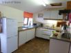Fitted kitchen includes a fridge freezer, electric cooker & microwave